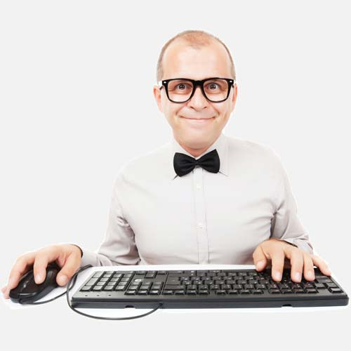 Man with glasses and dikie bow tie using computer