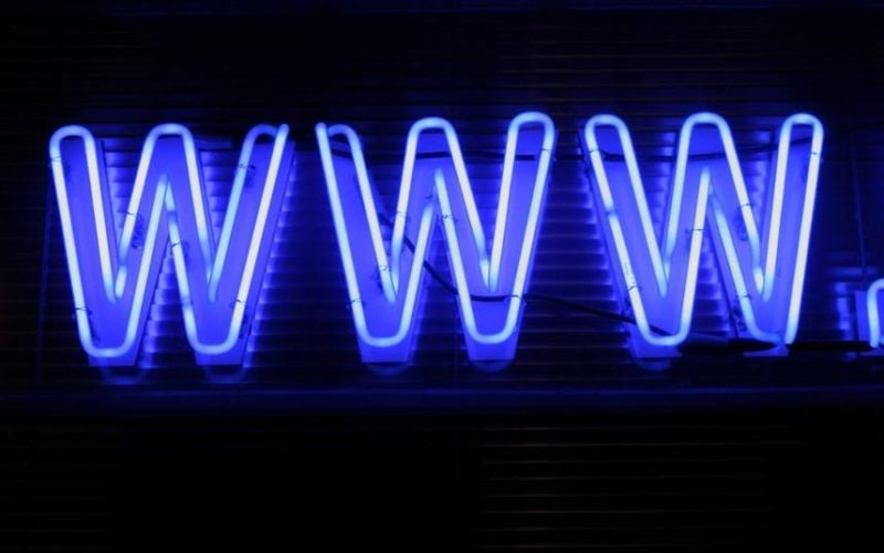 Blue neon www. logo on black background