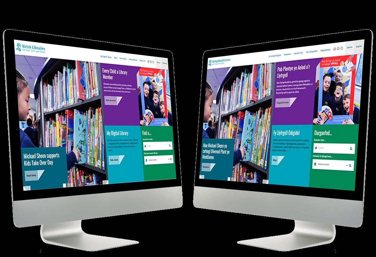 Two Mac computers displaying bilingual websites