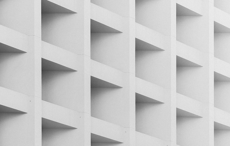 A close-up shot of a white cubby shelf