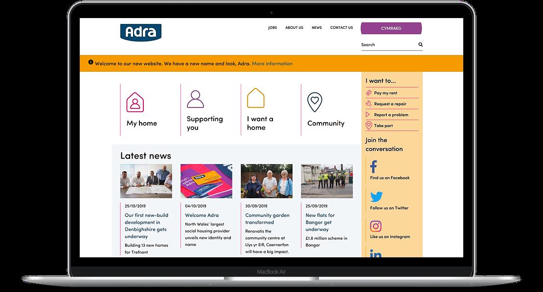 Adra website displayed on laptop